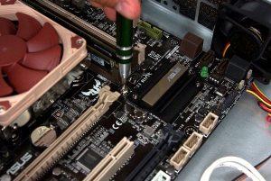 Screwing in Motherboard