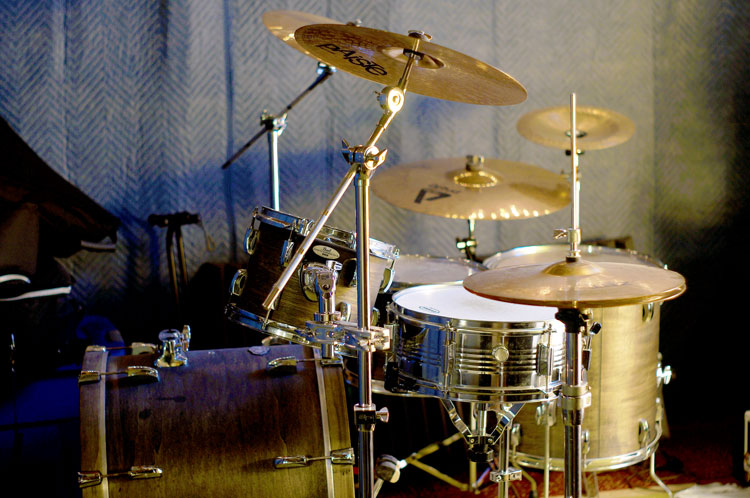 Drum Kit with Moving Blankets Around It